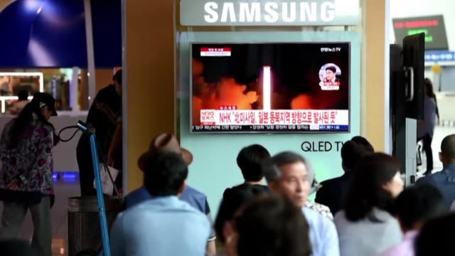 people in seoul watch news reports after north korea fired a ballistic missile over japan and into the pacific ocean - north pacific ocean stock videos & royalty-free footage