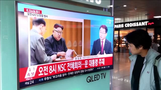 people in seoul watch television news reports after north korea fired a ballistic missile over japan and into the pacific in response to fresh un... - north pacific stock videos & royalty-free footage
