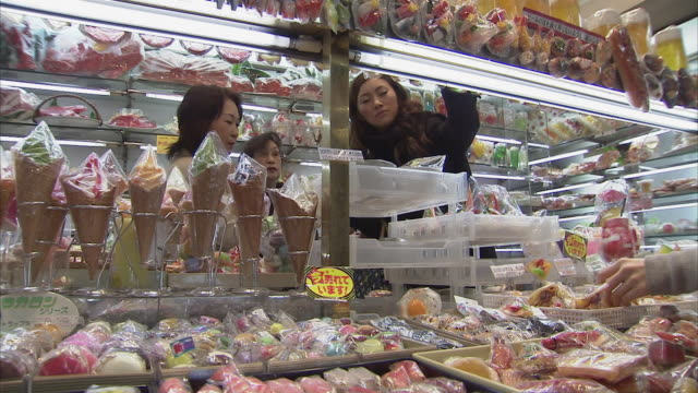 ms people in shop with plastic food, tokyo, japan - japan stock-videos und b-roll-filmmaterial
