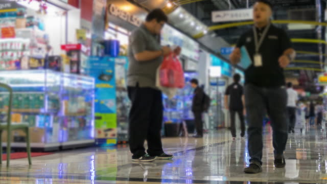 People in shopping corridor, time lapse.