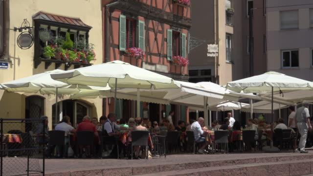 People in sidewalk cafe in Colmar