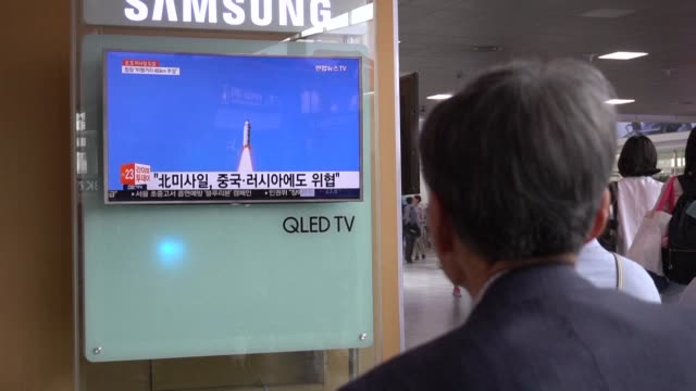 people in south korea react to north korea's missile test the latest in a series of provocative launches that have ratcheted up tensions over its... - nuclear missile launch stock videos & royalty-free footage