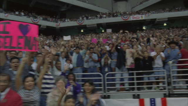 ws, pan, people in sport stadium applauding on concert, houston astrodome, texas, usa - transparent stock-videos und b-roll-filmmaterial