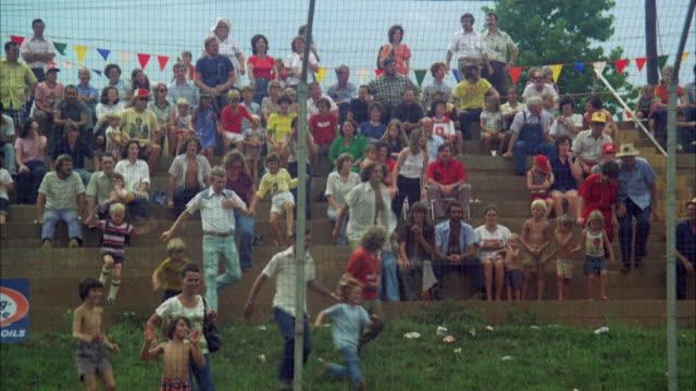 WS TD People in stadium watching car racing at Danville speedway / Georgia, USA