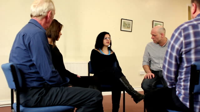 People in Support Group - Young woman speaking, Counselling, Therapy