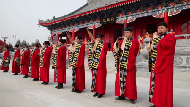 MS People in taoist costume playing traditional instruments in temple AUDIO / xi'an, shaanxi, china