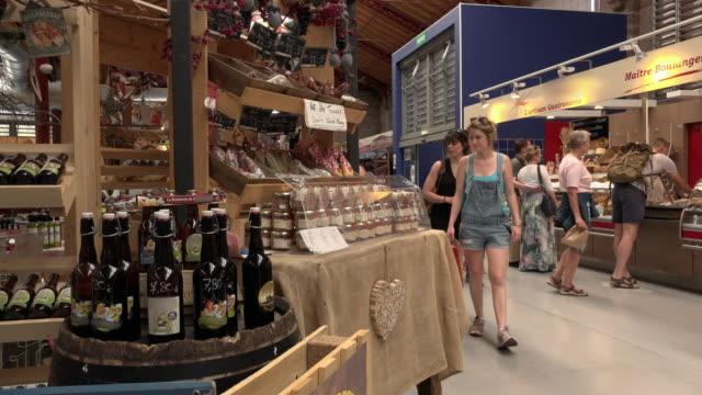 People in Terroir covered market in Colmar