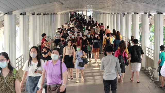 people in thailand who live during the coronavirus or covid-19 outbreak even though the epidemic is declining, people are still protected by wearing face masks. - editorial stock videos & royalty-free footage
