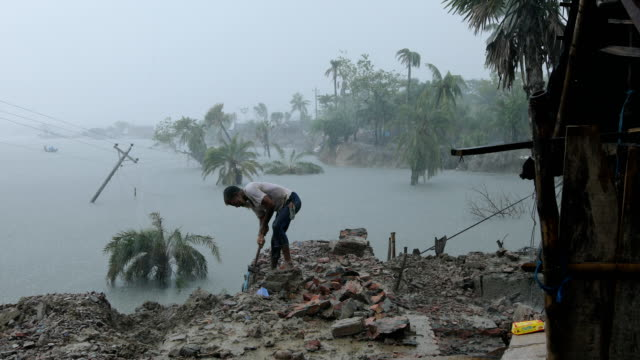 people in the coastal area in bangladesh on september 16, 2020. bangladesh is one of the country's most vulnerable to the effects of climate change.... - natural disaster stock videos & royalty-free footage