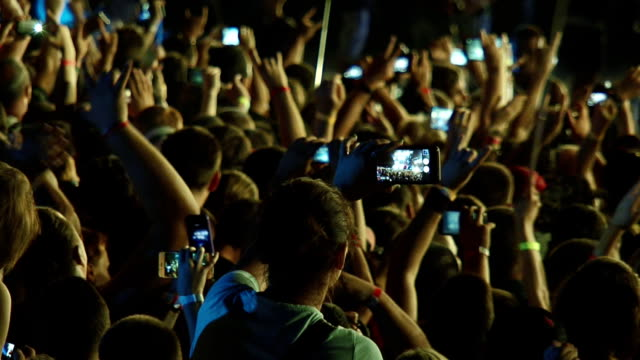 people in the crowd removed the show on smartphones