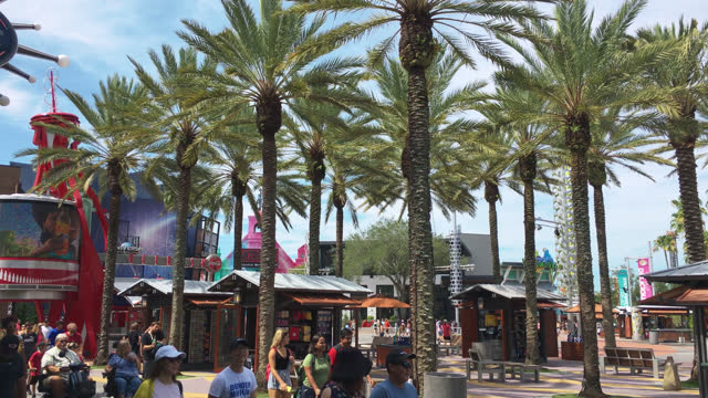 stockvideo's en b-roll-footage met people in the general area at the entrance of universal studios seen on july 20, 2019; in orlando, florida, usa. universal studios' famous recreation... - redactioneel