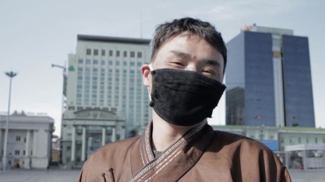 people in the mongolian capital ulaanbaatar react to the country going into lockdown to prevent the spread of the virus - ulan bator stock videos & royalty-free footage