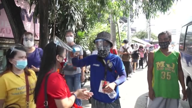 people in the philippines are resigned to a new normal, that wearing a face shield and mask is now mandatory in indoor public spaces and on public... - philippines stock videos & royalty-free footage