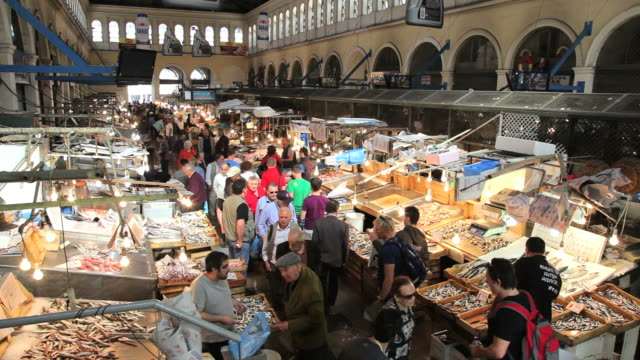 people in the popular central fish market in the centre of athens, greece, europe - griechenland stock-videos und b-roll-filmmaterial