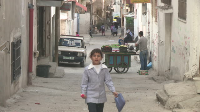 people in the street, balata refugee camp, palestine - palestinian territories stock videos and b-roll footage