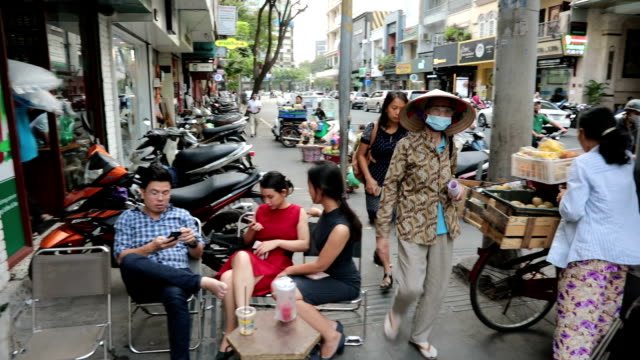 people in the street, ho chi minh city, vietnam - vietnam meridionale video stock e b–roll
