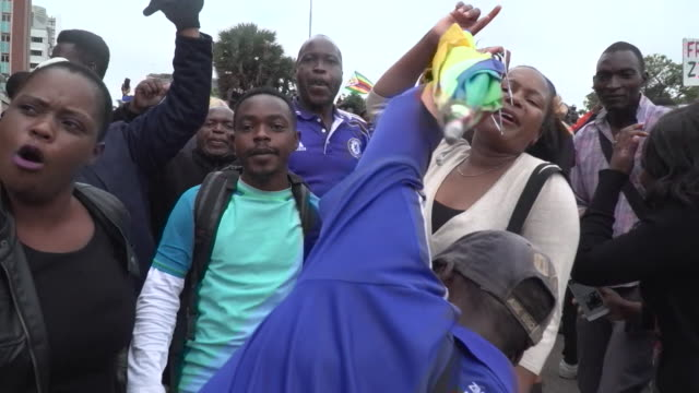 people in the streets of harare celebrating the military coup to remove president robert mugabe from power - zimbabwe stock videos & royalty-free footage