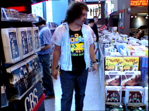 people in tower records browsing the shelves for music - tower records stock videos & royalty-free footage