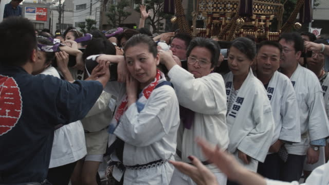 ms people in traditional clothing carrying mikoshi (portable shinto shrine) at kanda matsuri (shinto festival), tokyo, japan - shoulder ride woman stock videos & royalty-free footage