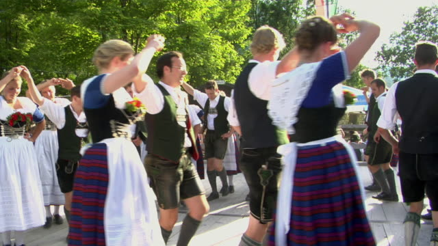 ms people in traditional clothing dancing at tegernsee folk festival, tegernsee, bavaria, germany - traditioneller tanz stock-videos und b-roll-filmmaterial