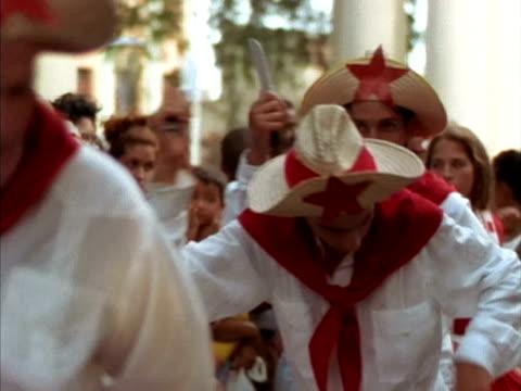 stockvideo's en b-roll-footage met cu, pan, people in traditional clothing dancing on street, cuba  - strohoed