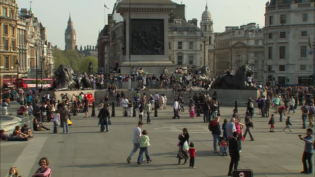 people in trafalgar square in london with big ben visible in the background - music or celebrities or fashion or film industry or film premiere or youth culture or novelty item or vacations stock videos & royalty-free footage