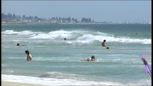 people in water at beach in perth australia - water sports equipment stock videos and b-roll footage