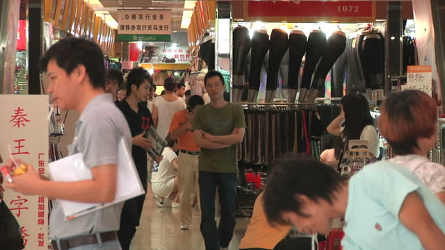 MS People in wholesale clothing market / Guangzhou, China