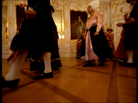 vídeos de stock, filmes e b-roll de people in wigs bow and greet each other in an ornate ballroom. - 18th century