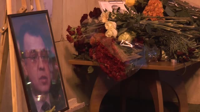 people including members of turkish community in russia lay flowers in front of the russian foregin ministry to pay tribute to russian ambassador to... - assassination of andrei karlov stock videos & royalty-free footage
