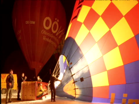 people inflate hot air balloons at night alps - making点の映像素材/bロール