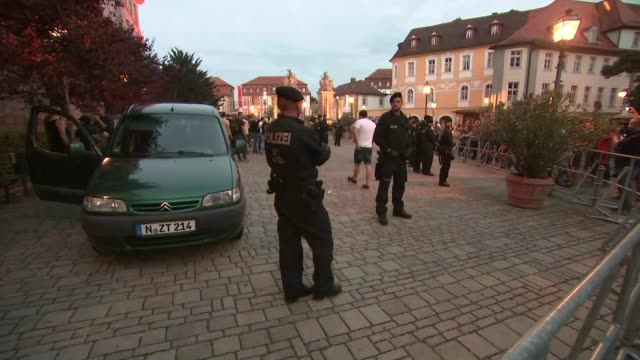 15 people injured in suicide bomb attack near music festival 2572016 Ansbach Various shots of police officers and rival groups of protesters