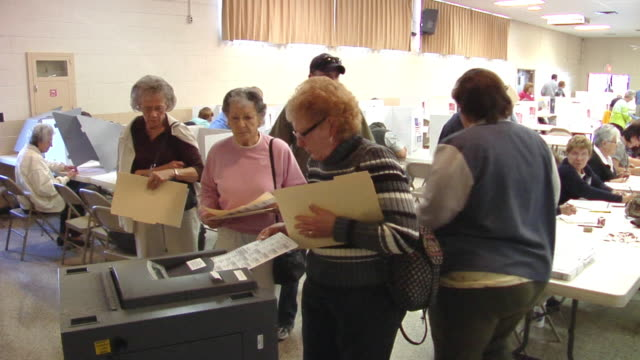 ms, people inserting voting ballots into ballot box, st. marys, ohio, usa - voting ballot stock videos and b-roll footage