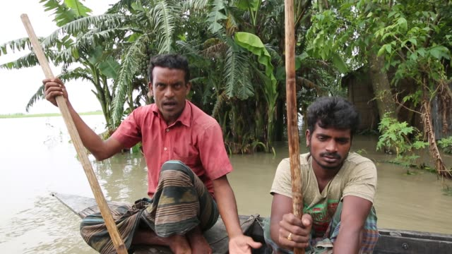 people interviewed near their submerged houses during flood in the northern part of bangladesh heavy monsoon rains have unleashed landslides and... - environmental damage stock videos & royalty-free footage