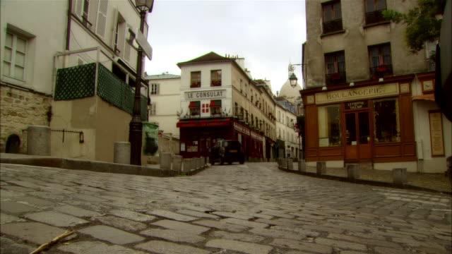 People jogging on cobblestone street / Montmartre, Paris, France