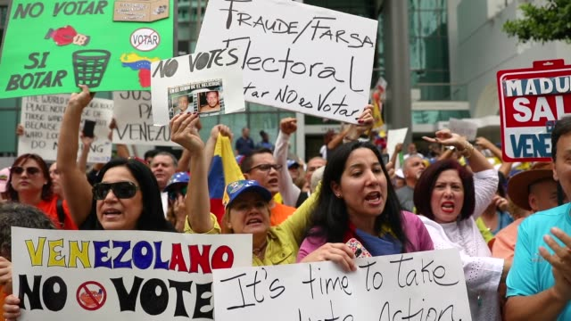 people join together in front of the consulate general of venezuela in miami to protest against the venezuelan elections taking place on may 20, 2018... - venezuela stock videos & royalty-free footage