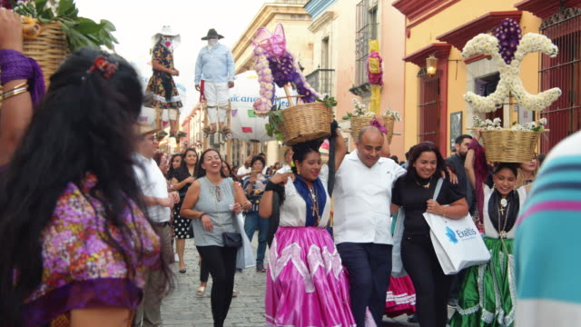 people joyously participating in the calenda street celebration in oaxaca, mexico - indigenous culture stock videos & royalty-free footage