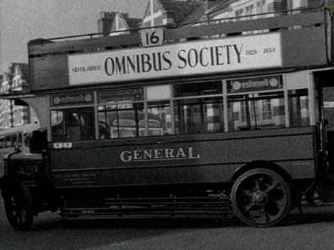 people jump onto the back of a moving vintage bus. - double decker bus stock videos & royalty-free footage