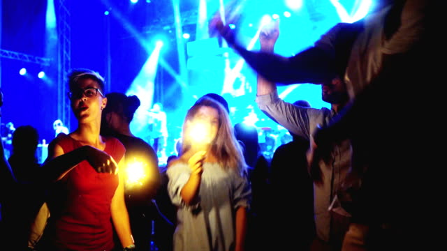 people jumping and dancing with sprinkle on concert - lightship stock videos & royalty-free footage