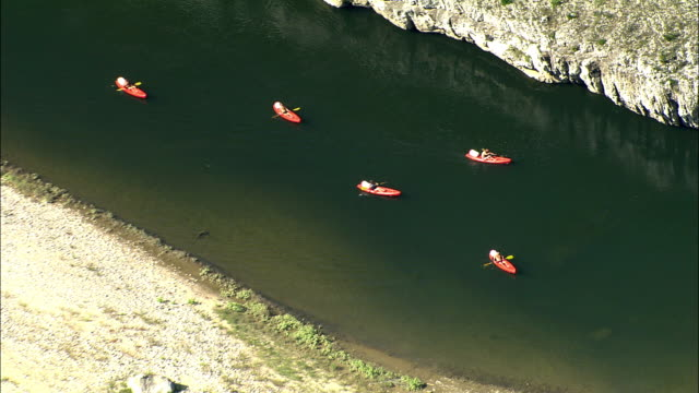 zo, aerial, people kayaking on river rhone, france - rhone river stock videos & royalty-free footage