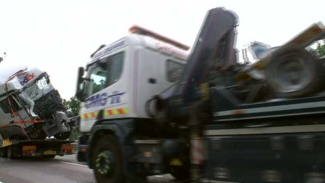 8 people killed after minibus and two lorries crash on m1 buckinghamshire near newport pagnell m1 wreckage of vehicles involved in crash being driven... - itv weekend evening news stock-videos und b-roll-filmmaterial