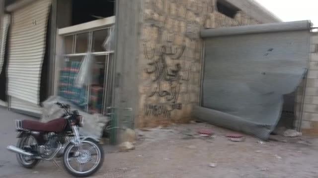 10 people killed and 25 others were injured after a helicopter of syrian army attacked with a barrel bomb on the albab district of aleppo which is... - isil konflikt stock-videos und b-roll-filmmaterial