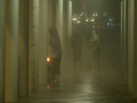 People lashed by wind and rain, Typhoon Koppu, Hong Kong on night of 14th sept 2009. With Audio.