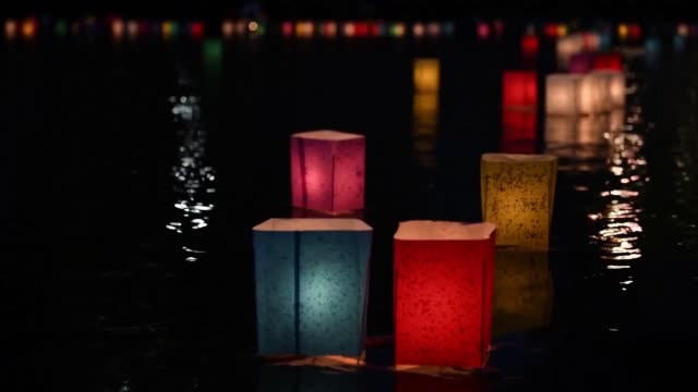 people launch lanterns for the hiroshima peace memorial ceremony and peace message lantern floating ceremony in hiroshima japan to mark the 74th... - lantern stock videos & royalty-free footage