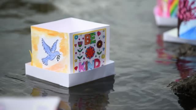 people launch lanterns for the hiroshima peace memorial ceremony and peace message lantern floating ceremony in hiroshima japan to mark the 74th... - frieden stock-videos und b-roll-filmmaterial