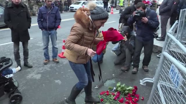 people lay flowers and light candles outside the istanbul nightclub where a gunman killed 39 people - gunman stock videos and b-roll footage