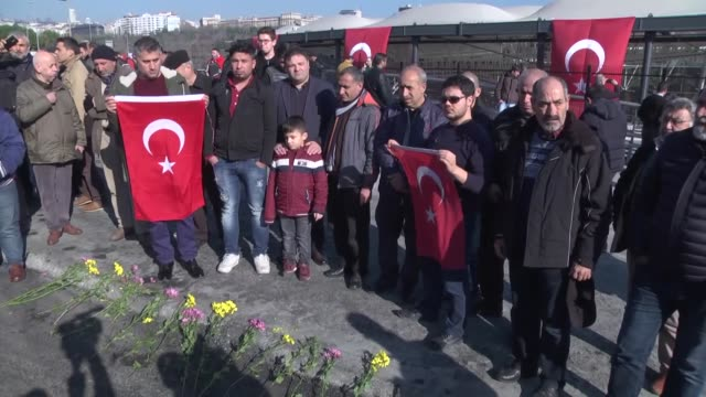 people lay flowers at the site of the terror attack and pray for the victims of the twin blasts near the besiktas football club stadium vodafone... - besiktas stock videos and b-roll footage
