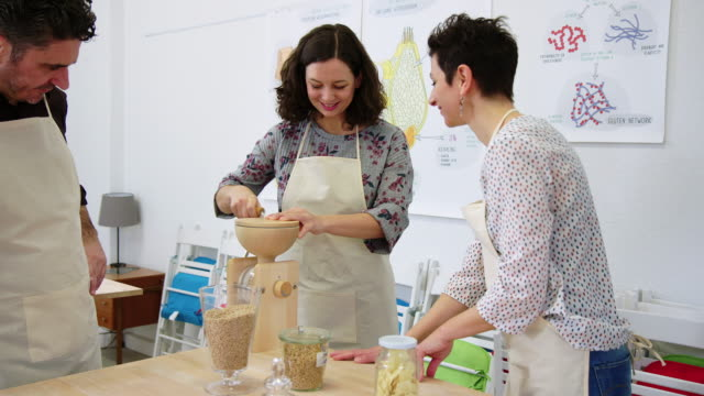 people learning making pasta flour at cooking class - flour mill stock videos & royalty-free footage