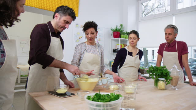people learning to make pasta in cooking class - instructor stock videos & royalty-free footage