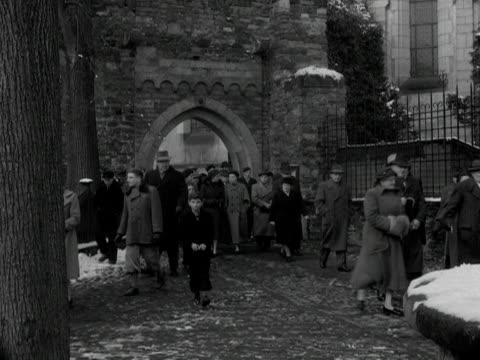 stockvideo's en b-roll-footage met people leave a church following a service in remagen. 1955. - winterjas